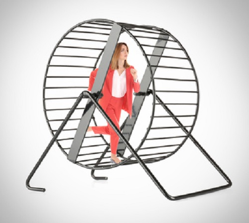 Young woman running in wheel on light background. Business rat race concept